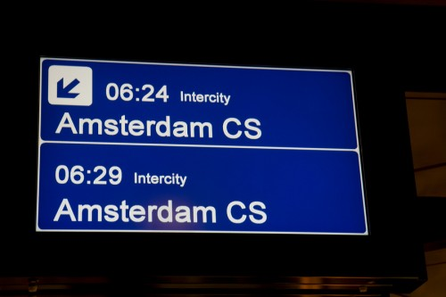 Look for a train that goes to Amsterdam Centraal (Amsterdam CS).